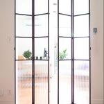 Dubbele Stalen vouwdeuren met heel veel glas