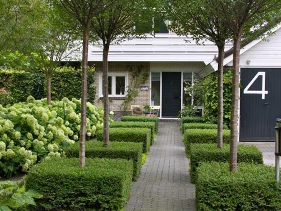 Grote voortuin ideee n wooninspiratie - Landscaping modern huis ...