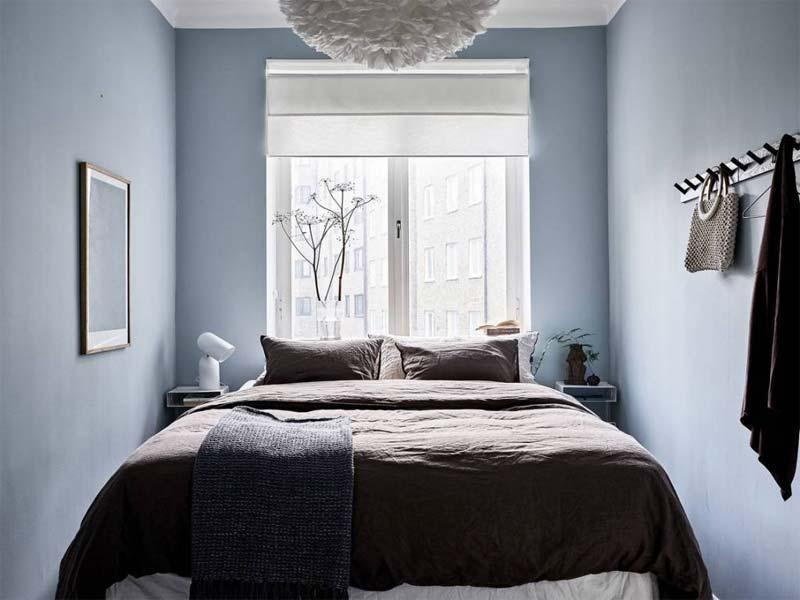 kleine slaapkamer blauwe muren