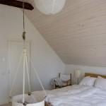Slaapkamer met Leander babywieg