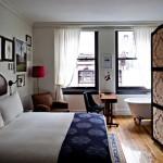 Slaapkamers van het Nomad hotel